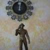 Luxury - detail sochy horníka a starožitné hodiny